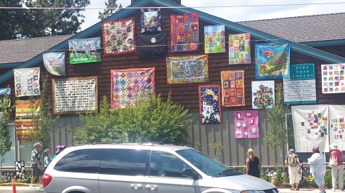 side of the quilt shop in Sisters with quilts hanging. very cool