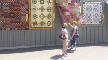 my mom and aunt checking out the quilts